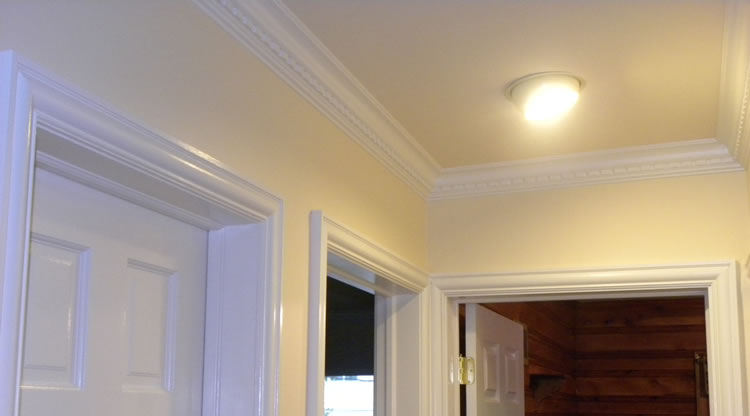 Door Casing and Crown Molding Installed By Craftsman Contracting.