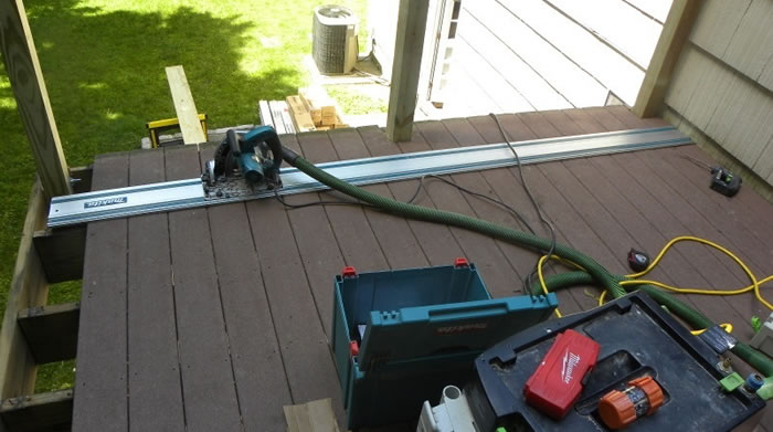 Using a Rail Saw To Cut The Deck With Precision.